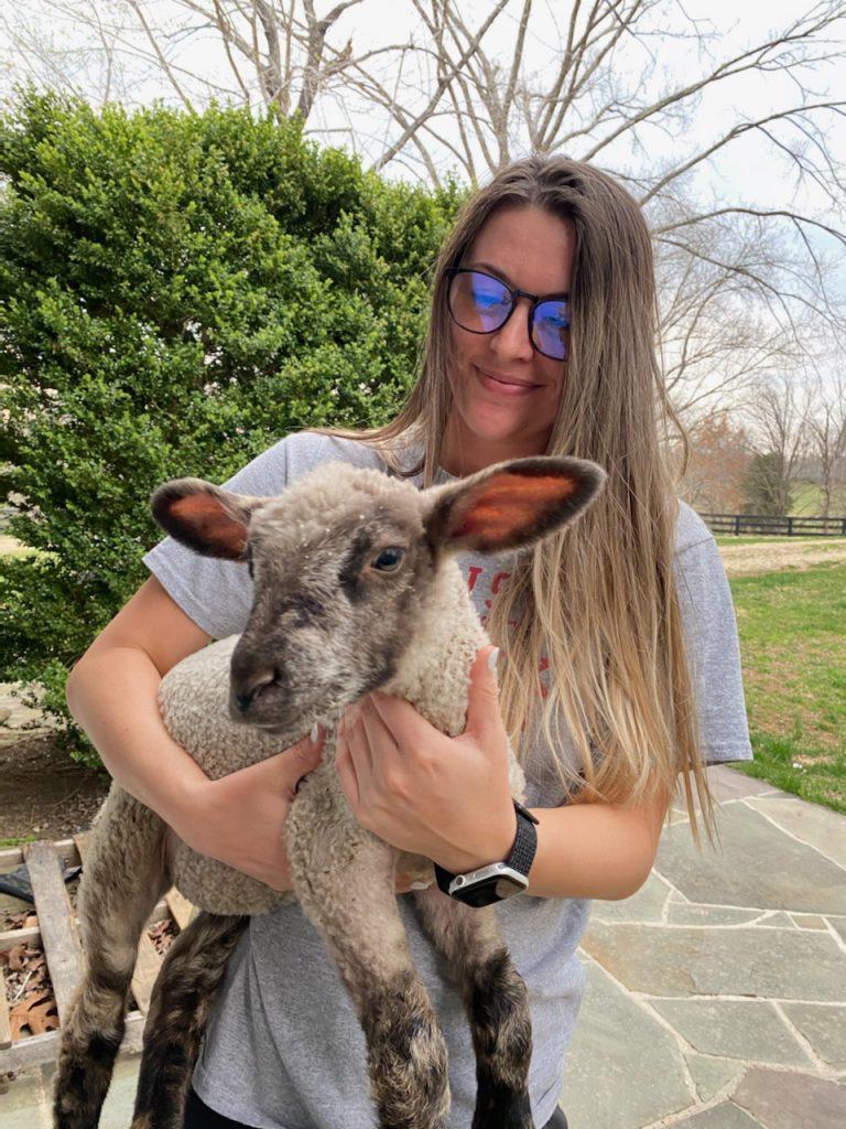 Mackenzie Mason and lamb.