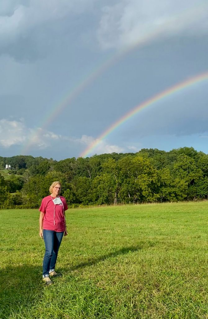 A rainbow finds daughter Carolyn inspecting one of our newly-seeded pastures.
